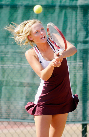 Alexandria's Michelle McFerran returns a volley to Lapel's Stephanie Pritchett during the tennis sectional championship at Highland on Friday.
