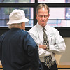 Joe Buck, South Madison Schools Superintendent, answered questions from people as they toured the old 1936 high school building Monday afternoon.