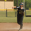 Lapel High School infielder Kirsten Rich thows the ball to first base during the Bulldogs Sectional game against Shenandoah High School. Lapel won the contest by a score of 6 to 2.