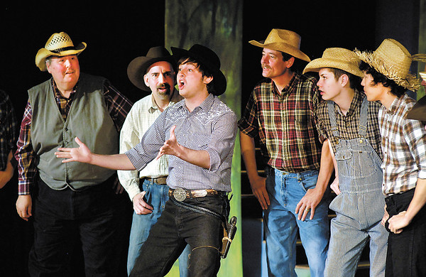 """Zachary Ryan Allen as Will Parker gets locals to dance in the musical """"Oklahoma!"""" The production runs this weekend and next at Anderson's Mainstage Theatre, 124 W. Ninth Street."""