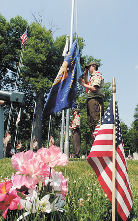 The flags of all six branches of the military were raised during the Memorial Day ceremony at Maplewood Cemetery conducted by Boy Scout Troop 301.  Here the United States Merchant Marine flag is being raised.