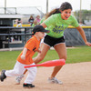 Haydynn Fox runs the bases along Kinzie Davis as Champions baseball plays at Pendleton Heights' Legends Field on Saturday.