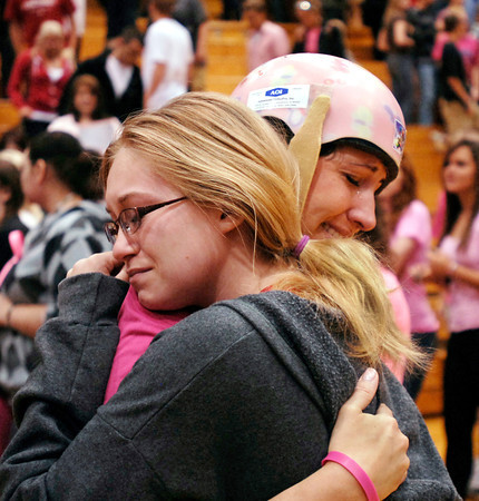 Andrea Vellinga shares a hug and some tears with Pendleton Heights High School junior Laura Barr, 17, after Vellinga finished addressing the students during a Friday morning convocation.