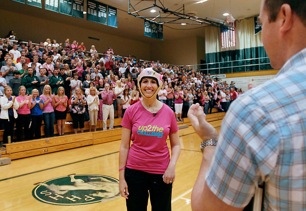 Andrea Vellinga gets a standing ovation from the Pendleton Heights High School student body after speaking to them during a Friday morning convocation.