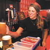 Allie Kregers serves up a couple beers at Amazing Joe's Grill in Muncie.