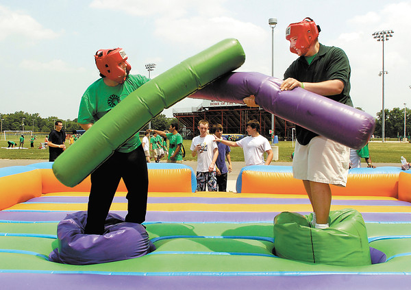 Adam Perdue and Brandon Daniels, both AHS juniors, battle each other on the inflatable battle field during the schools' Student Appreciation Program  Friday afternoon.  The program rewards well-behaved students with a carnival of fun activities and food at the end of the school year.