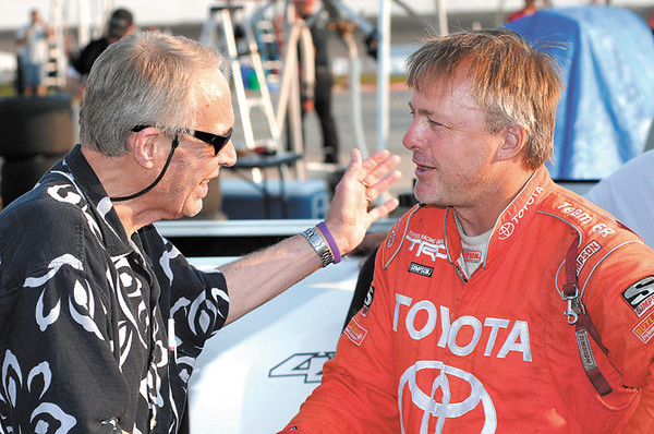 Larry Contos greets driver Brian Tyler before the start of the Little 500.