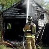 Anderson firefighters battled a garage fire Thursday morning in the rear of 2414 W. 28th Street.  The structure was totally destroyed  by the blaze.