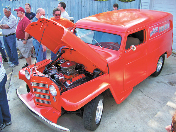 "Steve Griffith and many friends completed body work, painted, added graphics (which spell ""Holtski's Delivery Service"") and rebuilt the engine of this 1948 Willys Jeep Delivery Sedan for Steve Holt."