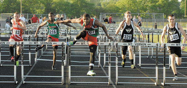 Anderson Indian Derek Dabney placed first in the 100 meter hurdle at the Sectional. Finishing to his right is teammate Isaac Miller and Bobby Brown of Frankton High School.