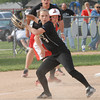 Madison Grant infielder Kayla Stanley fires the ball to first base after checking the runner on third.