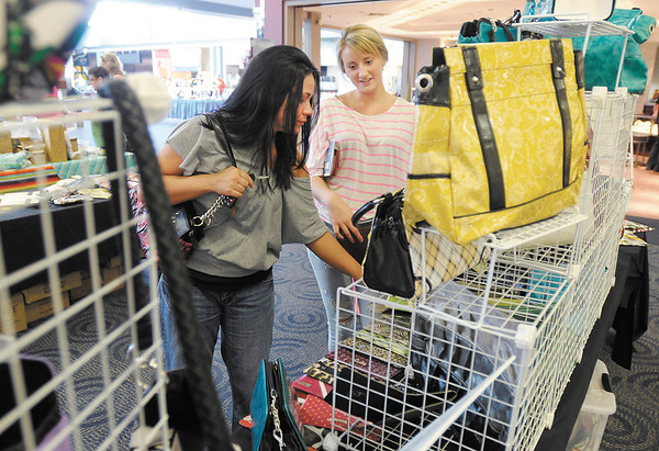Susan Cagley and her step daughter Taylor shop for purses at the Miche booth during the Mother's Day Gift and Hobby Show at Mounds Mall on Saturday. The show continues today at the mall.