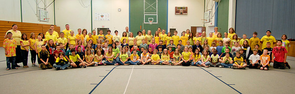 10-year old Kayte Hopper, who suffers from Osteogenesis Imperfecta,( or brittle bones) is surrounded by her classmates at East  Elementary School to help her celebrate Wishbone Day 2012 by having a group photo taken with everyone wearing yellow.