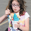 Alexis Snoddy, 10, enjoys her cotton candy flavored snow cone at Sno-Castle on Broadway in Anderson. Sno-Castle opened for the season on May 1st. Summer like temperatures Thursday afternoon made the cool confection a popular treat.