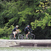 APD officers John Wilson and Brandon Grant ride the trails around Shadyside Lake Wednesday as the Anderson Police Department has reinstated the police bike patrols during nice weather.