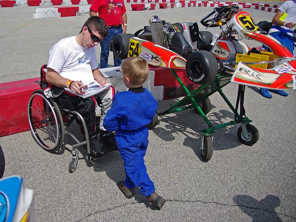 Michael Johnson signs an autograph for fellow driver P. J. Eicher.