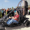 Pete Bitar takes off in his Thrust Buggy as he demonstrated it for these Highland Jr. High School students Tuesday.  Bitar gave a presentation to the students on some of his inventions and how important math and science is to be successful in life.