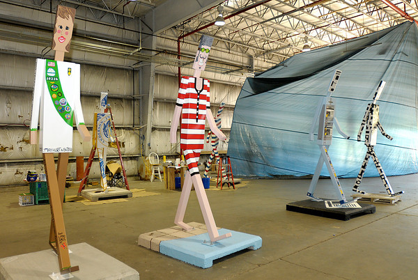 The Walking Man project was created by artists Levi Rinker and Laree Blazer. The sculptures will be on display around the city from June through September.
