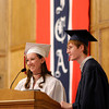 Indiana Christian Academy Class of 2012, from left, Deeann Owen and Adam Brown, announce their class gift of a banner for the school during graduation on Friday.