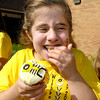 10-year old Kayte Hopper, who suffers from Osteogenesis Imperfecta,( or brittle bones) celebrated Wishbone Day 2012 with her classmates at East  Elementary School by eating yellow cupcakes decorated with the Wishbone logo on top.  Here kayte gets tickled as she tries to eat her cupcake.