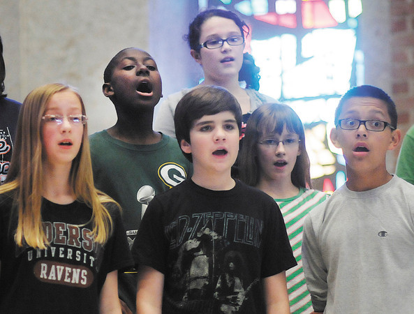 Members of The Anderson Area Children's Choir Youth Chorale reheares at the First United Methodist Church on Tuesday. The Choir will be performing their 20th season concert on May 6th.