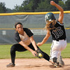 Madison Grant shortstop Olivia Stroup readies to put a tag on Arabian runner Tiffany Wertz at second base.