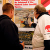 Sam Mudd, right, points out information on the Occupy Anderson display at the Earth Day-Arborfest festival last Saturday.