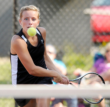 Lapel's Meg Fields eyes the ball as she returns a volley to Lapel's Abby Matthew in the tennis sectional championship at Highland on Friday.