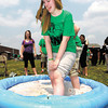 "Anderson High School senior Amanda Fuller reacts to being in "" the tub of yuck"" as she participates in one of the activities for students during the student appreciation program Friday."