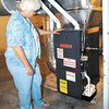 Judith Skinner shows the new furnace that was put in by the Central Indiana Community Action Program that replaced their 53 year-old furnace.