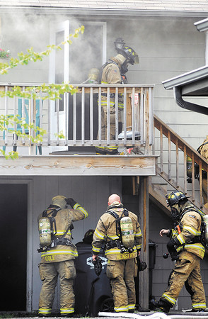 Anderson firefighters fought a smoky garage fire with an apartment on the second level Tuesday afternoon in the 2900 block of Columbus Ave.