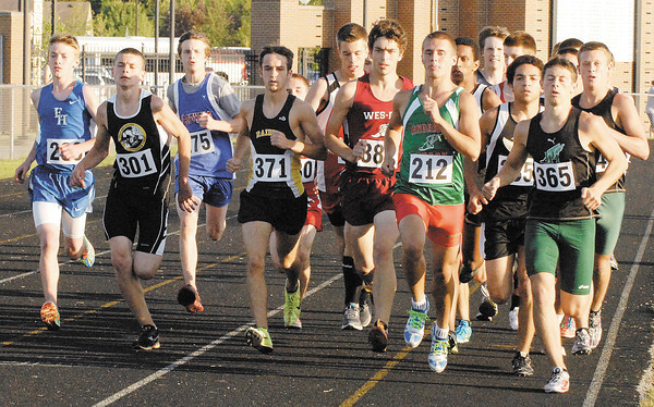 Anderson High School's Cameron Gall (#212) and Pendleton Heights' Brandon Smith sets the pace for the 1600 meter run.