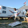 Scott King and Christine Stauffer play a game of corn hole while camping at the Anderson Speedway on Thursday.