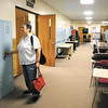 Sherry Humfleet checks out the old lockers as she goes through the old Pendleton High School building.
