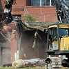 Work began Monday morning on the demolition of the old Emge building on west 8th Street in Anderson.  Klenck Company out of Indianapolis was awarded the contract for the job.