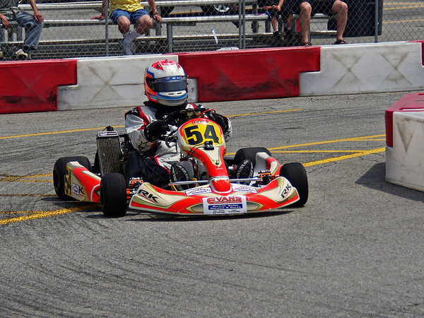 Michael Johnson slides through the turn on his way to victory in the TaG Kart final.