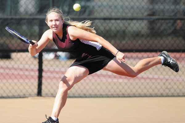 Alexandria's Sarah-Kate Brenner returns a volley to Frankton's Alexa Munger during the tennis sectional semi final at Highland on Thursday.