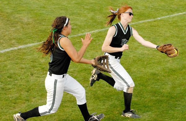 Pendleton Height second baseman Sarah Dixon makes a nice running catch in foul territory with Kinzie Davis backing the play up.