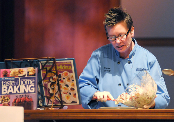 Chef Dana Elliott prepares Summer Potato Salad during the Taste of Home Cooking School at Madison Park Church of God on Thursday.