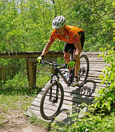 """A rider opts for the ramp instead of jumping from the end of """"The Pier"""" at while participating in the Mountain Bike Trail Ride event held Sunday at the Rangeline Nature Preserve as part of National Mike Month."""
