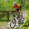 "A rider opts for the ramp instead of jumping from the end of ""The Pier"" at while participating in the Mountain Bike Trail Ride event held Sunday at the Rangeline Nature Preserve as part of National Mike Month."