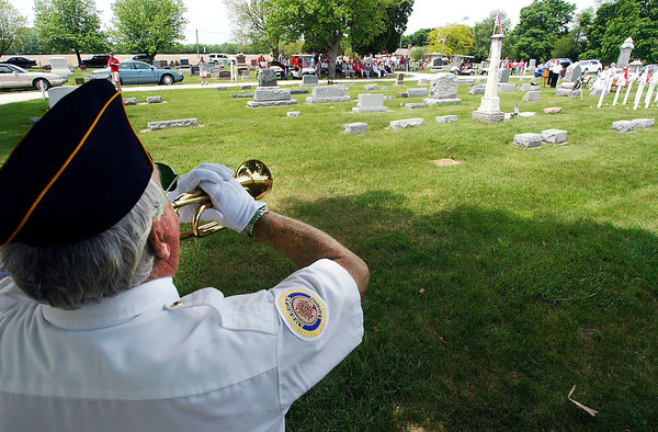 John P. Cleary | The Herald Bulletin<br /> The Lapel American Legion Post 212 Honor Guard bugler Rick Woodword plays Taps during the Memorial Day Service by the Lapel American Legion at Brookside Cemetery Monday.