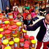 "John P. Cleary | The Herald Bulletin<br /> Olivia Fox stacks the last of the more then 570 jars of peanut butter her and her 2nd grade East Elementary classmates have collected for ""Real Hope for Haiti.""  Olivia, who was born in Haiti, was adopted by missionaries and brought to the United States."