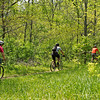 Riders head into the woods at the Rangeline Nature Preserve during the Mountain Bike Trail Ride held in observance of National Bike Month.