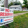John P. Cleary | The Herald Bulletin<br /> A sign against the proposed Mounds Reservoir on east 18th Street in the Irondale neighborhood.