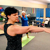 John P. Cleary | The Herald Bulletin<br /> Instructor JoAnn Hutchins leads her yoga class at White River Club this past week.