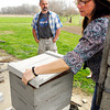 John P. Cleary | The Herald Bulletin<br /> Crystal Ostler raises the lid on one of their bee haves as Tom looks on where most of the bees died off last fall and the handful that remained couldn't survive the harsh winter.