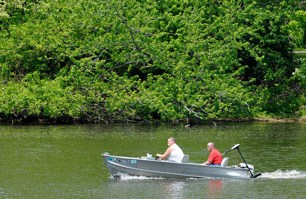 Don Knight | The Herald Bulletin<br /> A pair of anglers are under way to their next spot at Shadyside lake on Wednesday. Weather forecasts for the holiday weekend are calling for sunshine and 70s.