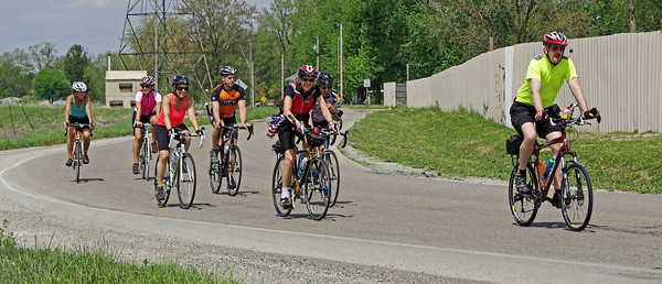 Riders in the Anderson CycloFemme Mother's Day event cruise along Ridge Road on their way to a stop at Good's Candy Shop.