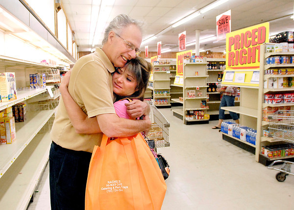 John P. Cleary | The Herald Bulletin<br /> John Cox of Cox Supermarket gets a hug from Lisa Minnick, a 7-year employee of the store before being laid-off because Cox is closing the grocery as of this Saturday.  Minnick was in the store shopping and wanted to thank Cox for the time she had worked for him.